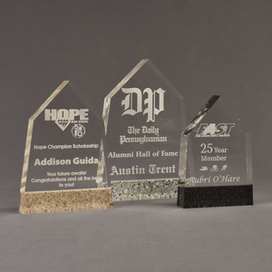 Three Composites™ Obelisk Acrylic Awards grouped showing Staron® Aspen Brown, Platinum Grey and Sanded Black Onyx accent options.