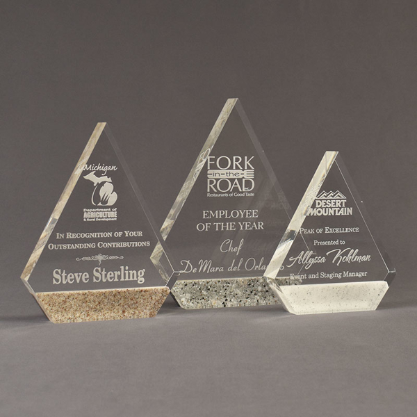 Three Composites™ Peak Acrylic Awards grouped showing Staron® Aspen Brown, Platinum Grey and Sanded White Pepper accent options.