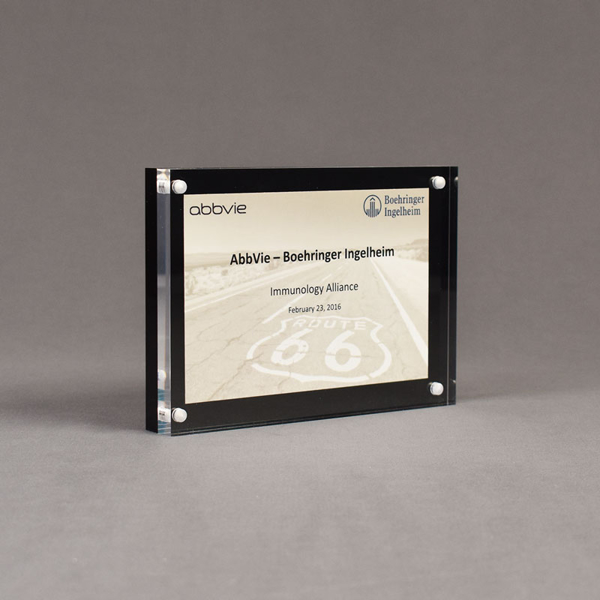 "Angle view of Allure™ 5"" x 7"" Acrylic Entrapment Award with printed Boehringer Ingelheim message placed between black back and clear acrylic."