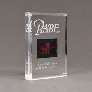 """Angle view of Allure™ 7"""" x 9"""" Acrylic Entrapment Award with studio film clip of Babe movie sandwiched inside two pieces of crystal clear acrylic."""