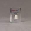 Angle view of small Allure™ Floating Acrylic Encasement Award with Exxon Infineum pellet sample encased into clear acrylic showing full color imprint.