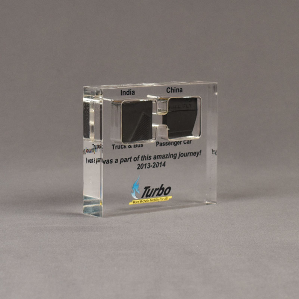 Angle view of medium Allure™ Floating Acrylic Encasement Award with passenger and truck tire sample encased into clear acrylic showing full color imprint.