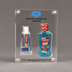 Front view of x-large Allure™ Acrylic Encasement Award with Colgate toothpaste and mouthwash bottle encased into clear acrylic showing full color imprint.