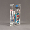 Side view of x-large Allure™ Acrylic Encasement Award with Colgate toothpaste and mouthwash bottle encased into clear acrylic showing full color imprint.
