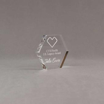 "Angle view of 3"" Aspect™ Hexagon™ Acrylic Award featuring CVS logo laser engraved with Legacy Award text."