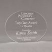 "Front view of Aspect™ 6"" Oval™ Acrylic Award featuring laser engraved Lincoln Property Company logo and Top Gun Award text."