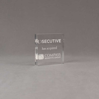 """Angle view of Aspect™ 3"""" Square™ Acrylic Award featuring SECUTIVE logo laser engraved and Compass Benefits Group text."""