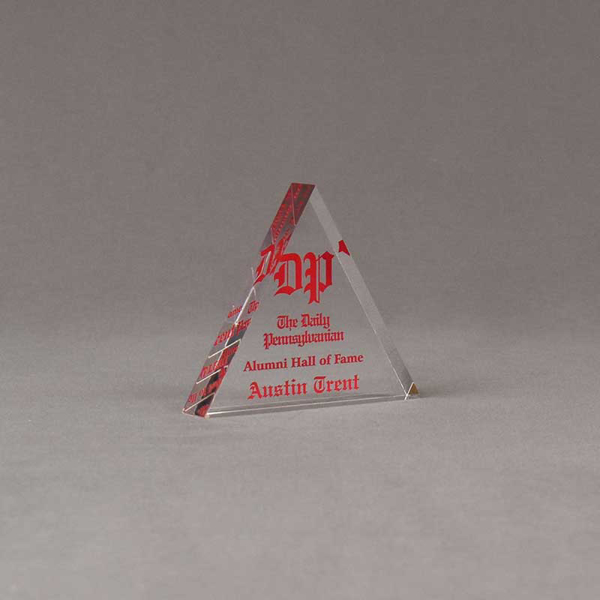 "Angle view of Aspect™ 4"" Triangle™ Acrylic Award featuring the Daily Pennsylvanian logo printed in full color with Alumni Hall of Fame text."