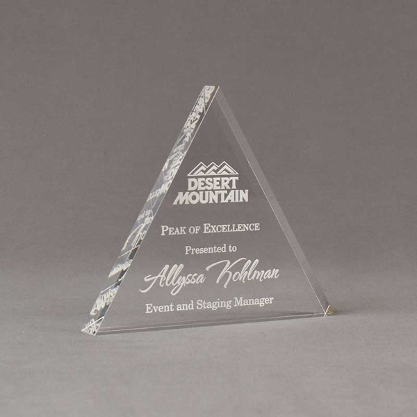 """Angle view of Aspect™ 6"""" Triangle™ Acrylic Award featuring Desert Mountain logo laser engraved with Peak of Excellence text."""