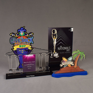 Four custom shaped Value Series LaserCut™ Acrylic Awards showing a Basketball Trophy, a Pillar of Excellence Award, a Nationals Award & a Presidents Club Trophy