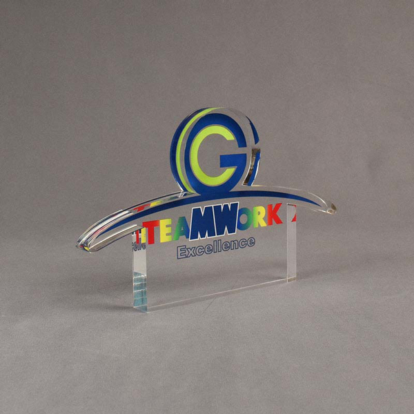Angle view of 65 Square Inch Elite Series LaserCut™ Acrylic Award with custom shape of TEAMWORK Excellence logo.