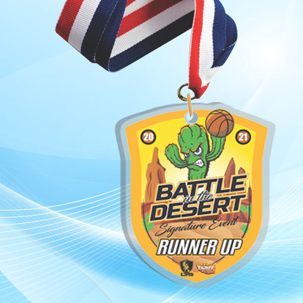 """2"""" LaserCut Custom Acrylic Medal with UV printed Battle in the Desert event logo and red white and blue neck ribbon."""